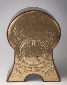 clock, ca. 1900-05. H. 41.5 cm. Mahogany. Area covering brass fitting, decorated with maple branches and landscape. Arabic numerals, chimes each hour on sound spring. Board signed: LENZKIRCH UAG.