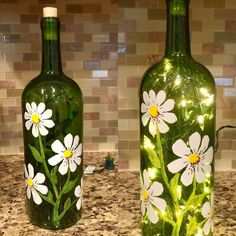 Hand painted by Angela Steward this recycled wine Painted Glass Bottles, Lighted Wine Bottles, Painted Wine Glasses, Bottle Lights, Decorated Bottles, Decorating With Wine Bottles, Bottle Lamps, Liquor Bottle Crafts, Wine Bottle Art