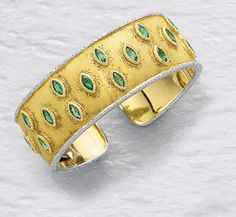 BUCCELLATI A Gold and Emerald Cuff  Designed as a textured gold hinged cuff, accented by marquise-cut emeralds, with white gold accents, mounted in 18K yellow and white gold.