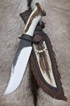 Custom Handmade Knives – Tomas Rucker. This is nice, antler handle, whitetail hide, fringed leather. I think I want one !