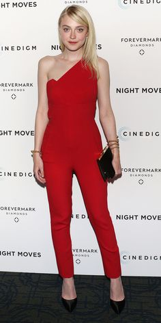 Dakota Fanning wears a one-shouldered red pantsuit by Roland Mouret Nortoni, Prada clutch, Paula Mendoza Nereus Bracelet, and Forevermark Ring