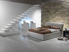 Design Ideas, Wonderful Basement Bedroom With Natural Stones Covered Walls Also White Floating  Stairs And Simple Bedding Sets: The Floating Stairs for Unusual Interior Design