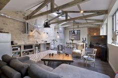 Eclectic / rustic / industrial loft in Paris. Love the grey couch, exposed beams, quirky decor, colourful tiles, stainless steel & vintage armchairs. Eclectic / rustic / industrial loft in… Style At Home, Paris Loft, Quirky Decor, Living Spaces, Living Room, Piece A Vivre, Industrial Loft, Industrial Design, Home And Deco