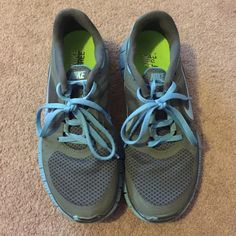 Used Nike frees 3 Slightly used sneakers. It is a blue and grey color! Still has lots of use left. Cute and comfy !!! Has the spot for the Nike thing that counts steps. Price firm Nike Shoes Sneakers