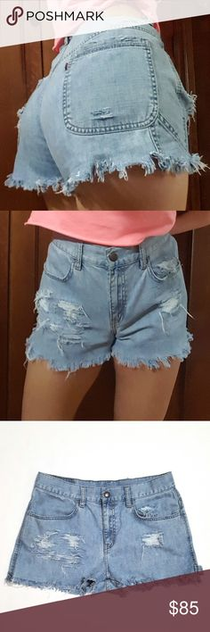 """Levi's Vintage High Waisted Denim Cutoff Shorts These are Levi's """"Mom Jeans"""" custom made high rise denim cutoffs. 100% cotton. Snap button at top. Light wash. *These run small* (I wear a 2-4 in modern jeans so I had to hold these up while modeling them but they're pretty small for a size 8. Measurements below. No stretch. Fading in general. Custom distressed denim. See pics.   Waist 14 7/8"""" across when flat, rise 10 1/4"""", inseam 2"""", leg width at inseam area 12.5"""". Measurements are…"""