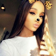 Ariana Grande taking a selfie in one of the Snapchat filters.:).