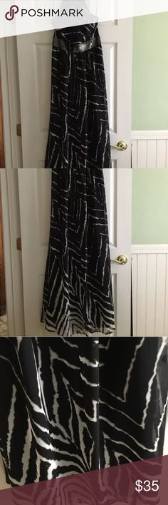 """EXPRESS SUMMER MAXI DRESS Zebra style EXPRESS SUMMER MAXI DRESS FABulous black and white flowing and flurty zebra print Sheer & fully lined Zebra bust sequin band No zipper, elastic back pull on pull over Sz M  * 34"""" BUST  * 68"""" Length  Dry Clean...ready to wear Please go by measurements and not size! Perfect for the beach to night social Please allow photos to be part of the description Express Dresses Maxi"""