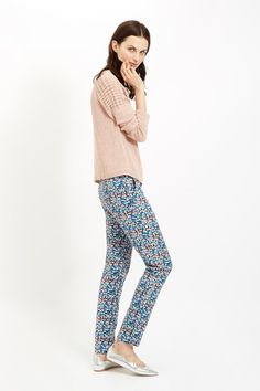 Multi coloured trouser with floral print in 97% certified organic cotton, 3% elastane. Hook and bar fastening with side pockets and single back pocket. Length 101cm.