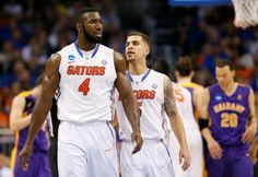 Patric Young reacts with teammate Scottie Wilbekin of the Florida Gators in the second half against the Albany Great Danes during the NCAA Tournament at Amway Center on March 2014 in Orlando, Florida. Florida Gators Basketball, Amway Center, Ncaa Tournament, Orlando Florida, Scottie, Two By Two, March, Orlando, Scottish Terrier