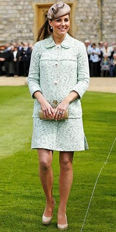 Royal mom-to-be Kate dresses her now visible six-months-pregnant belly in a mint green Mulberry coat, accessorized with nude LK Bennett heels for the National Review of Queen's Scouts celebration at Windsor Castle in Berkshire, U.K.\nhttp://www.peoplestylewatch.com/people/stylewatch/gallery/0,,20590676,00.html