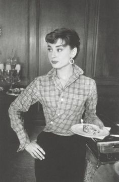 Audrey Hepburn on the set of 'Sabrina', 1954. They did this with their shirts back then too!