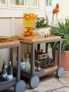 Make It Portable. A roll away cart provides storage and can works for large party serving.