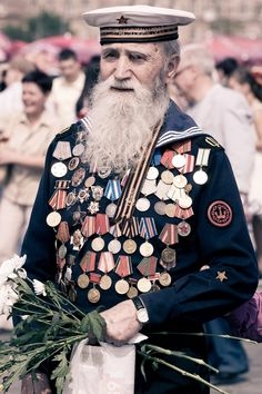 World War II Russian veteran wearing a Navy uniform with numerous orders and medals. 2000s, May 9 – the Victory Day in Russia.