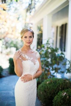 Southern Charm in the City - United With Love- illusion neckline bridal gown, lace bridal dress inspiration, classic wedding dress, cignon bridal hair, dramatic and classic bridal makeup