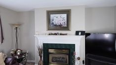DIY Fireplace Makeover Update Idea If you have an outdated living room decor check out this DIY makeover fireplace idea and learn this fireplace painting tips for DIY home decor on a budget. Fireplace Update, Home Fireplace, Fireplace Remodel, Fireplace Surrounds, Fireplace Design, Ideas For Fireplace Decor, How To Decorate Fireplace, Fireplace Mantle Decorations, Renovate Fireplace