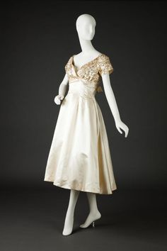 Débutante dress, Ceil Chapman, 1948 creamy white silk satin gown dress cocktail length beading on bodice shoulders shelf bust bow back pleats full skirt designer couture late 40s era post war