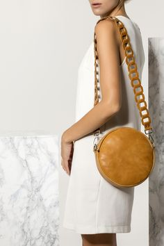 Shoulder bag handmade of high-quality calf leather, Ariadne design features our signature chain strap. Enjoy how this boho-chic piece is just the right size to hold daily essentials without weighing you down. Wear yours over the shoulder with free-spirited looks. It comes in 4 colors: camel/brown (waxed tan), black with white, black, nude (nubuck). Greek Chic Handmades Women's bags are designed and handcrafted in Athens, Greece from the same premium leather we built the sandals with. Leather Shoulder Bag, Shoulder Bags, Shoulder Strap, Round Bag, Brown Leather, Calf Leather, Unique Bags, Leather Bags Handmade, Leather Purses