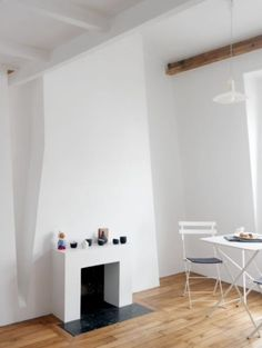 "This minimalistic fireplace is from our feature ""Pocketsized Paris"""