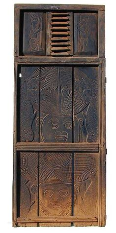 Africa | Bamileke (?) Cameroon Door. This tall door shows a European influence in its construction but has a wonderful carved design | © Tim Hamill