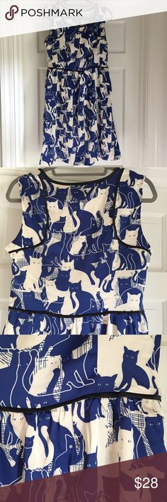"""Fit and flare cat print dress Adorable fit and flare cat print dress in royal blue and white. Black piping details. Purchased from Modcloth under the """"Frock Shop"""" brand. Fully lined. Hidden side zip. Pockets. Never been worn! Lining 100% cotton, shell 100% polyester. Length from shoulder to hem (lying flat) is 37.5"""" ModCloth Dresses"""