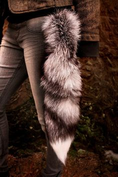 These tails are MASSIVE - many are over 25 inches long! Silver foxes are a melanistic (black) color variant of the familiar red fox (Vulpes v. Silver Fox Tail For Sale Werewolf Ears, Wolf Tail, Wood Badge, Fox Costume, Animal Tails, Wolf Stuff, Fur Accessories, Alley Cat, Animal Costumes