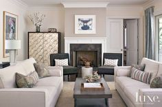 Interior designer Jennifer Dyer custom made the sofas in this traditional, neutral living room in a sophisticated Los Angeles home. Romo linen covers the sofas while accent pillows are a Robert Allen textile.