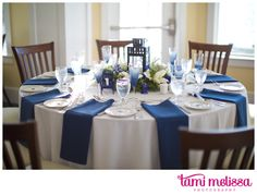 Navy blue and white. Napkins. DIY navy blue champagne glasses. Lantern centerpieces.