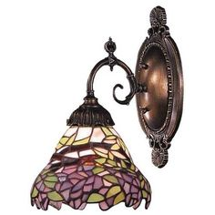 Westmore Lighting Mix-N-Match W Tiffany Bronze Wall Sconce at Lowe's. Mix-n-match tiffany bronze tiffany-style arm wall sconce. Bronze Wall Sconce, Wall Sconce Lighting, Wall Sconces, Hallway Lighting, Bathroom Lighting, Lotus Design, Tiffany Glass, Tiffany Art, One Light