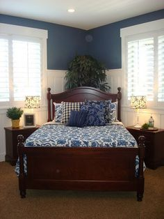 I like the plantation shutters, the bed at an angle, and the shades of blue.