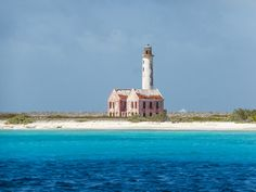 Abandoned lighthouse and keepers' quarters on the small, uninhabited island of Klein, Curacao, in the southern Caribbean. It's interesting to imagine someone once living there, keeping the light going... What a beautiful, lonely place.