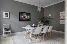 I like this connected dining and living room, each painted in a different shade of grey and decorated with grey, black and white furniture, accessories and green plants. Both rooms match each other so well, but also have a different … Continue reading →