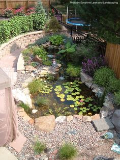 Water feature with lily pads and pebbles highlight this remodeled landscape. It's a good transition inside the home. #walkway