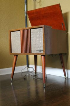My father in law has one of these a large version…gorgeous Retro Mid-Century Danish Modern AMC Turntable Record player