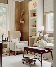Bookcases flanking sofa become storage, end tables and mounted swing arm lighting. |  James Douglas Interiors, LLC