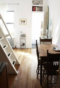 Two people share this tiny, 240-square-foot apartment in Brooklyn, N.Y.       movie video @ the bottom from ABC News of Graham's 400 sq. ft. apt. with movable wall for kitchen/living room/bedroom/dining room seems really cool and a neat concept on limited space.