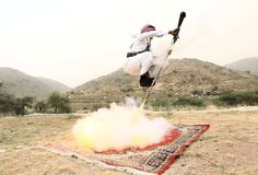 A man fires a weapon as he dances during a traditional excursion near the western Saudi city of Taif, August 8, 2015. Saudis usually party in such excursions as they celebrate weddings or graduations.