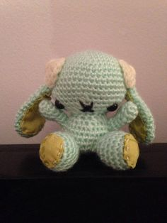 This handmade amigurumi bunny stands 3 inches tall. It is filled with polyester stuffing and is made with safety eyes that help prevent them from