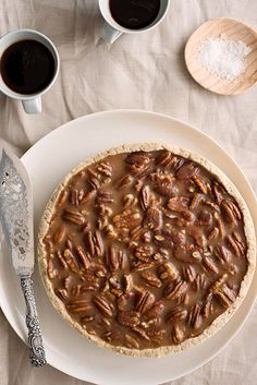 pecan salty caramel tart; the result is an incredibly sweet pie that is packed with pecans; it is highly addictive; the fleur de sel cuts through and balances out some of the sweetness
