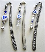 Simcha Carved Pewter Bookmarks will delight the reader! Choose a Star of David or a Chai, draped on a Plain or Graceful Hand bookmark. Flower-carved bookmarks also available by special order. Only $25 each.
