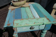 Broyhill Pine End Table, painted with a myriad of different hues of blue/green chalk paint.  Anthropologie pull.  https://www.facebook.com/ThePaintFactory