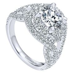 18K White Gold Woven Split Shank Style Halo Diamond Engagement Ring. This ring…