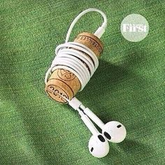 Wine cork ear bud wire keeper