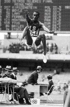 U.S. track and field athlete Bob Beamon flies through the air during his world record long jump of 8.9 meters at the 1968 Summer Olympics in Mexico City. Beamon's jump, which inspired a new adjective for spectacular feats ('Beamonesque'), stood as the world record for 23 years.