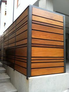 A unique combination of stained Mangaris lumber and Kynar-painted steel posts defines this Manhattan Beach, California fence from Ecocentrix Landscape Architecture.