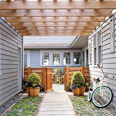 side yard transition space with grass pavers, and wooden gate. something like this might even work for a driveway?