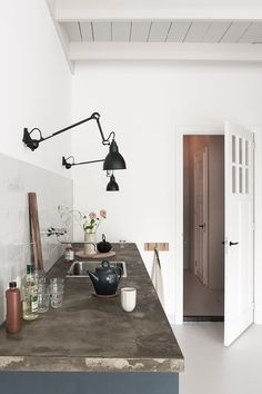 Black wall mounted task lighting in the kitchen black Lampe Gras wall lights kitchen lighting Kitchen of the Week: The Curtained Kitchen, Dutch Modern Edition - Remodelista Kitchen Lamps, Kitchen Chandelier, Home Decor Kitchen, Decorating Kitchen, Studio Kitchen, Kitchen Decorations, Rustic Chandelier, Kitchen Sink, Kitchen Lighting Design