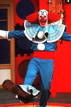 i used to get up at ridiculous hours to watch Bozo the Clown. i think i was 4 or 5 at the time. no wonder i find clowns creepy nowadays ;)