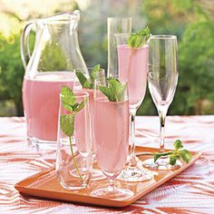 Sparkling Punch Recipe—Stir together 1 (12-oz.) can frozen pink lemonade concentrate, thawed, and 4 cuprs white cranberry juice cocktail in a large pitcher. Cover and chill 1 to 24 hours. Stir in 1 qt. club soda, chilled, just before serving. Garnish, if desired, with fresh mint sprigs.    For Champagne Punch, substitute 1 (750-milliliter) bottle extra-dry Champagne or sparkling wine and 1/4 cup orange liqueur for club soda, proceed with recipe as directed. | SouthernLiving.com
