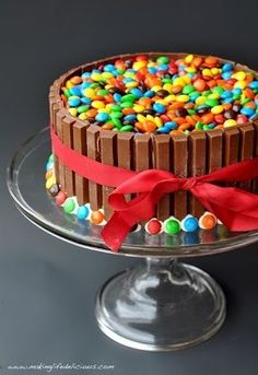 M&M & KitKat Cake -- decorating at its finest! (and easiest and tastiest! Best Dessert Recipes, Fun Desserts, Delicious Desserts, Cake Recipes, Food Cakes, Cupcake Cakes, Candy Cakes, Yummy Treats, Sweet Treats