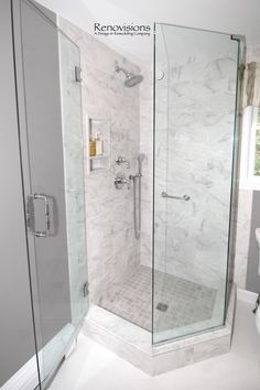 A completed full bathroom remodel by Renovisions. Neo-angle corner shower, glass shower door, transitional design, porcelain tile, large format tile, shower cubby, walk-in shower, hand-held shower, quartz countertop, green painted cabinetry.